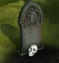 Image of a gravestone and a skull